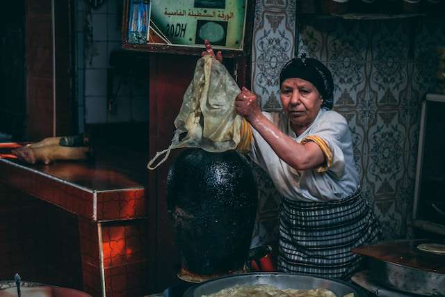 an old woman practicing food preservation in ancient time